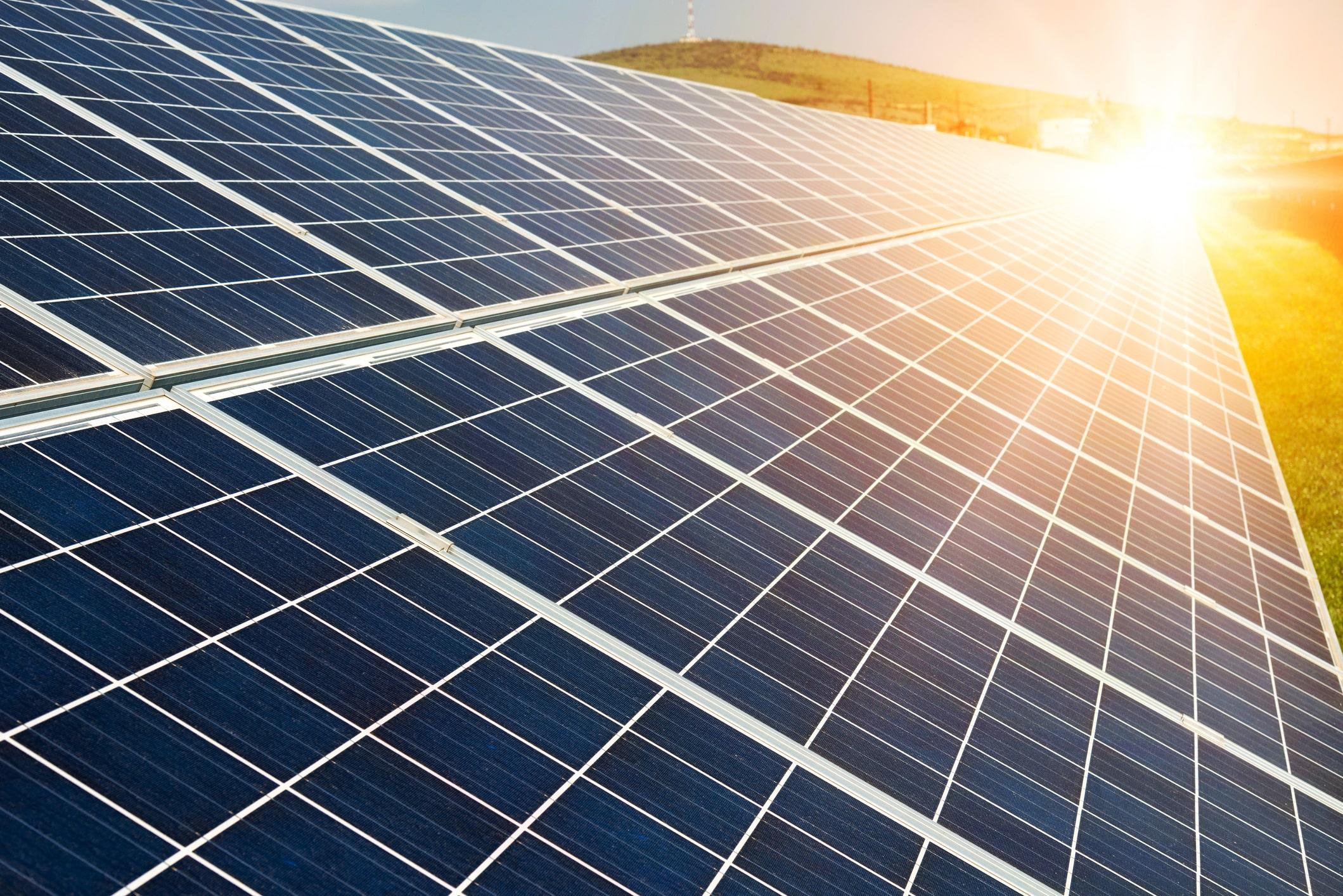 sun gleaming on solar panels