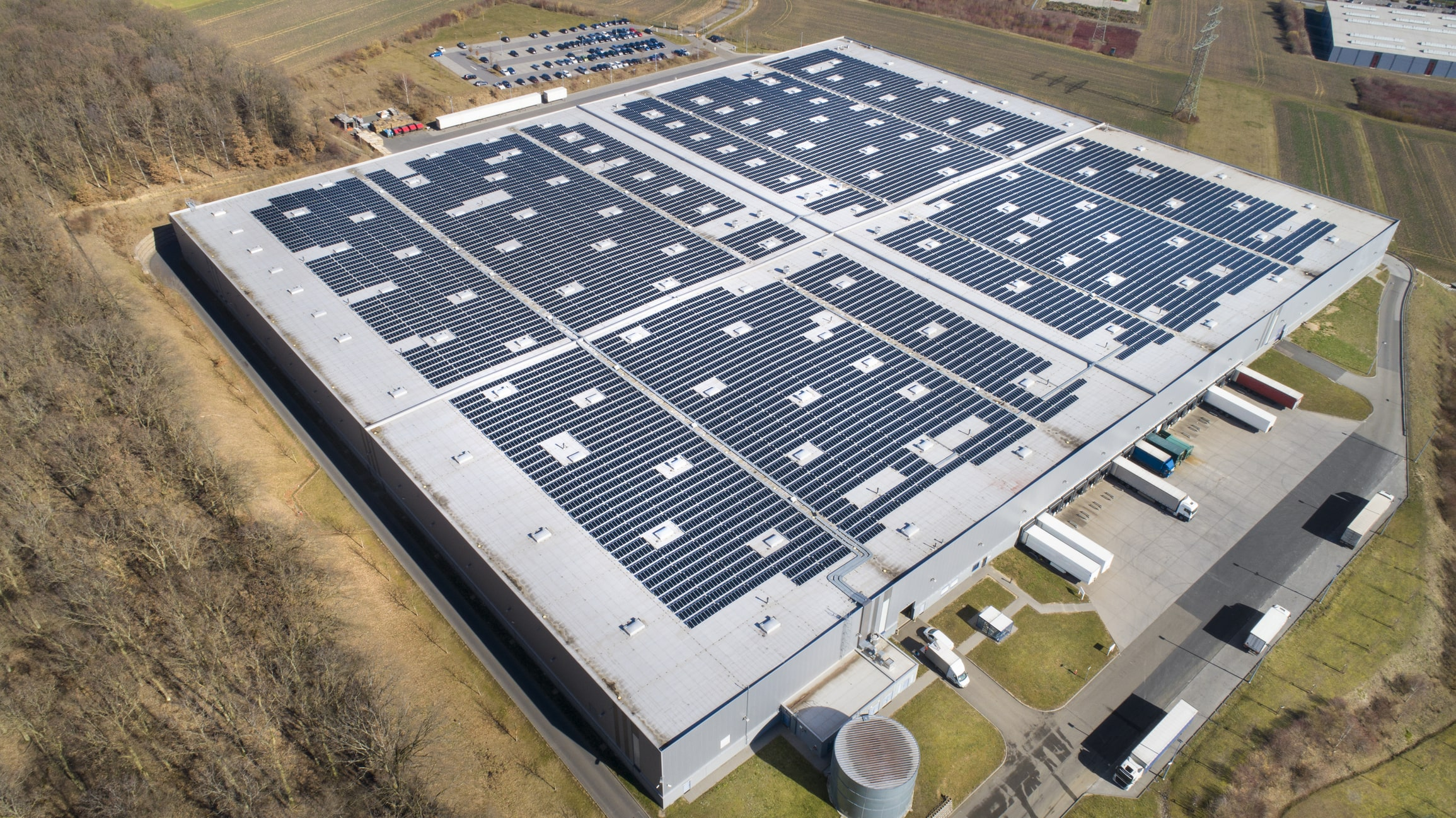 manufacturing plant with solar panels on the roof